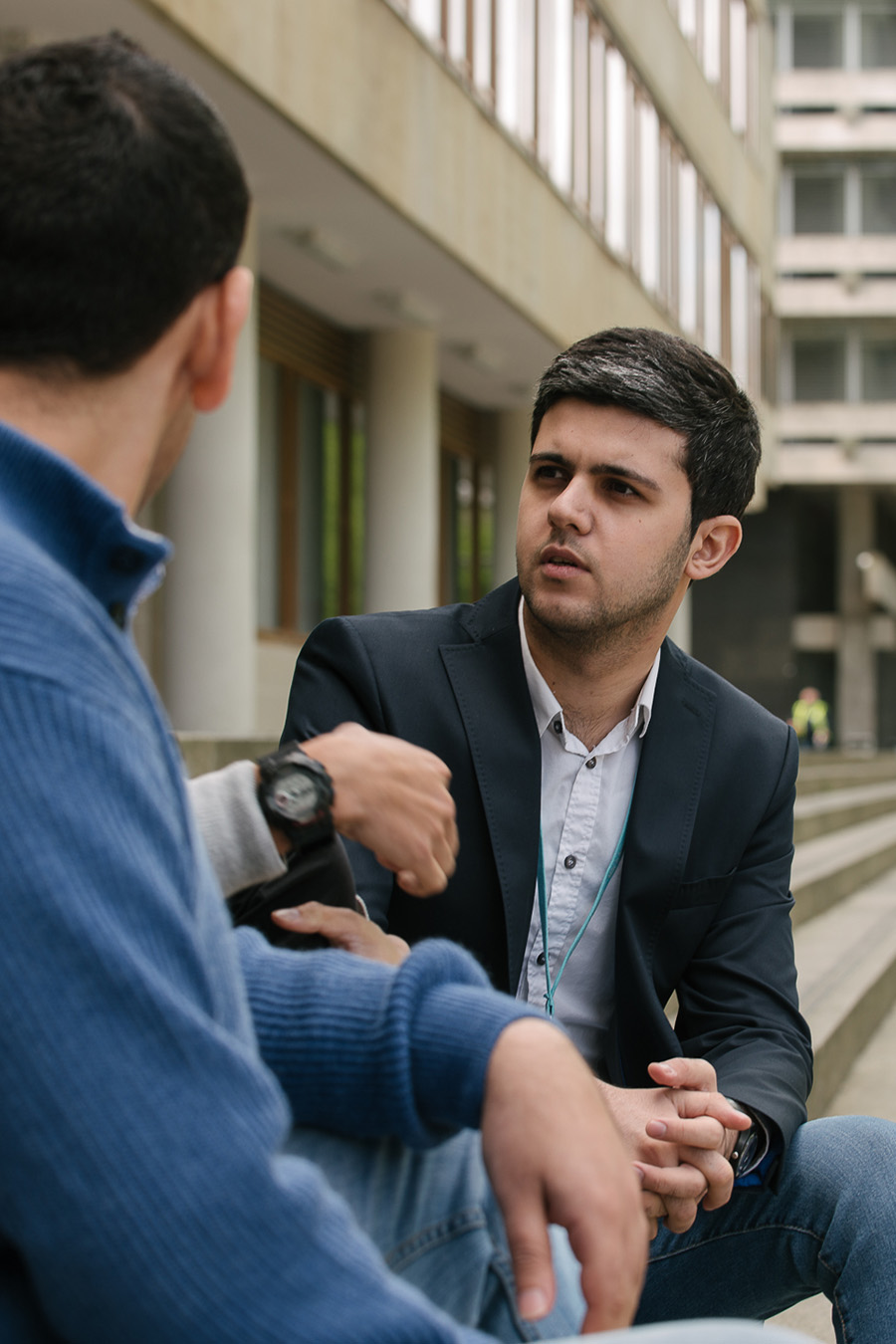 Three MBA students talking outside the Business School