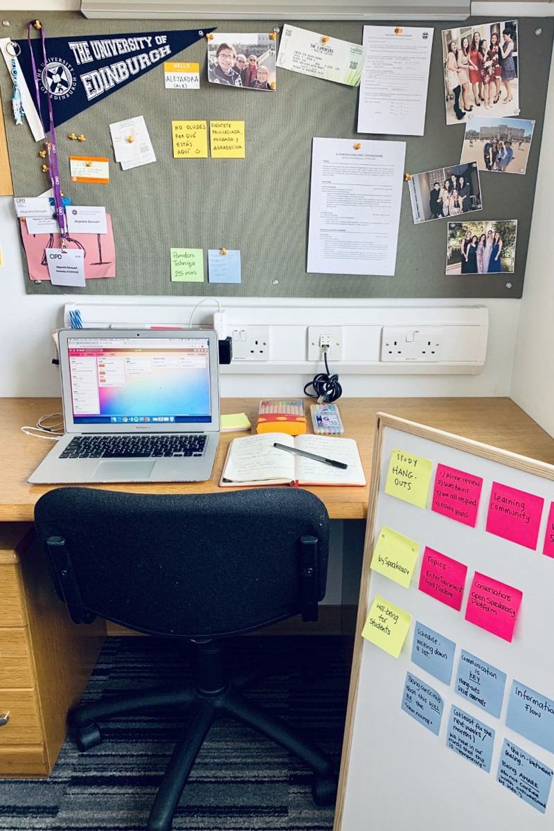 Workspace with laptop and noticeboard