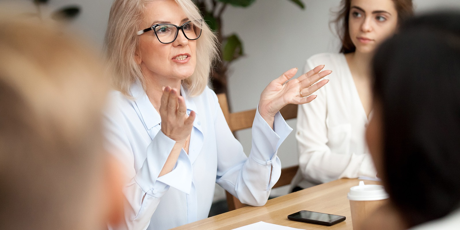 Mature woman in meeting