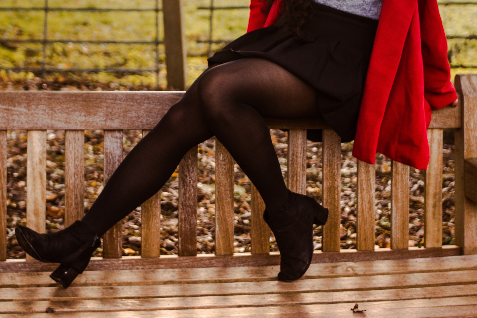 Person sitting on a bench in tights