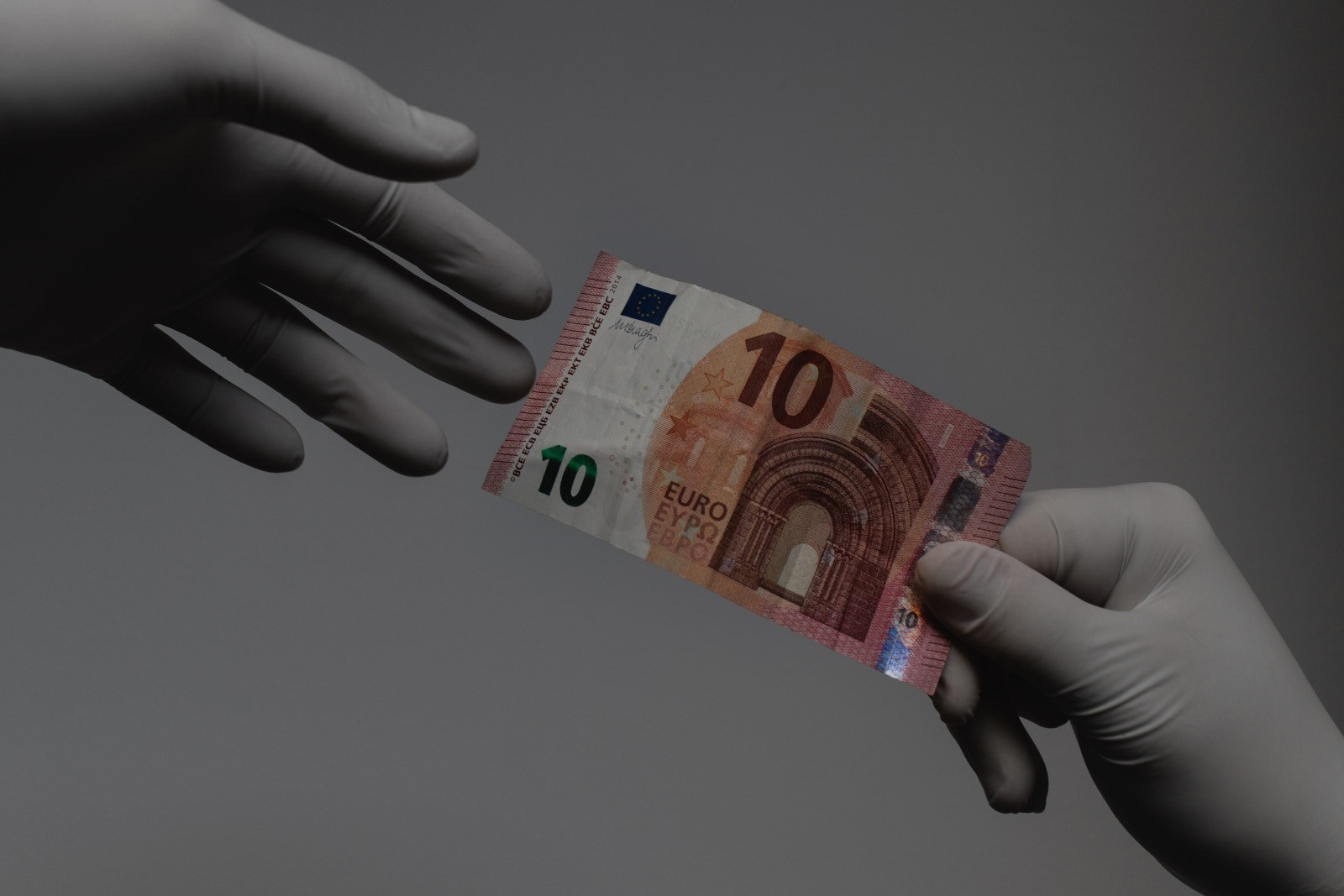 Accessing finance after COVID-19 - people handling money with gloves